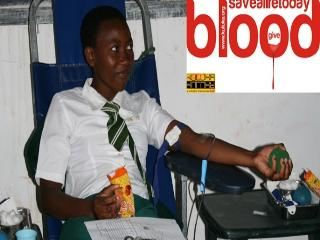 A happy blood donor at Royal Secondary in Malawi during a Kuluka blood drive